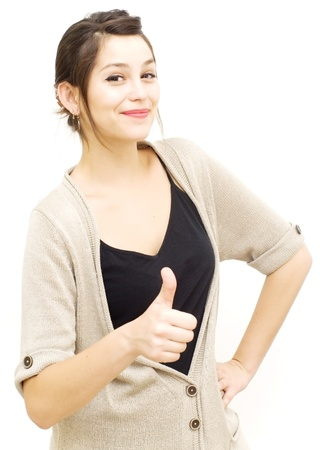 Look: Portrait of a young  woman with cardigan and her thumb up over white background Stock Photo