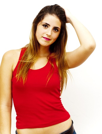 Portrait of a young  woman with red shirt touching her hair over white background