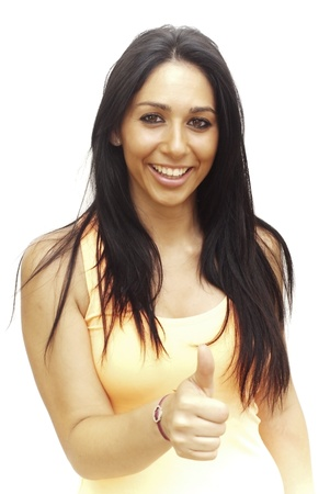 Portrait of a young  woman with yellow shirt and her thumb up  over white background