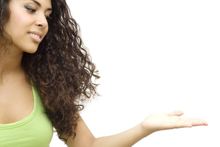 Portrait of a young  woman with green shirt looking in open hand over white background
