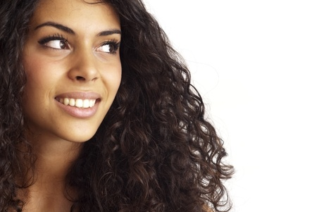 Portrait of a young  woman with a long beautiful hair over white background photo