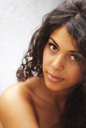 mixed race woman: Backlit portrait of an attractive woman  Stock Photo