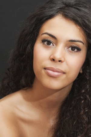 mixed race woman: Portrait of an attractive woman on black background