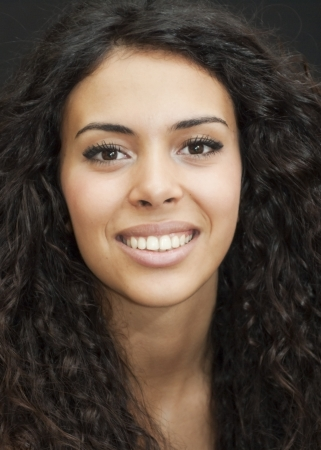 black woman face: Portrait of an attractive woman on black background