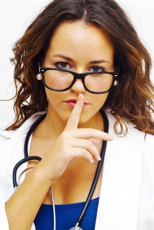 commanding: Pretty medical doctor woman commanding silence with glasses and stethoscope