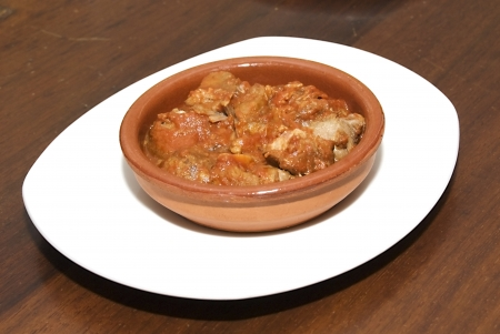 Plate of meat with tomato sauce photo