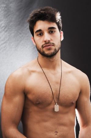 Backlit Portrait of  Handsome guy shirtless with beard  版權商用圖片