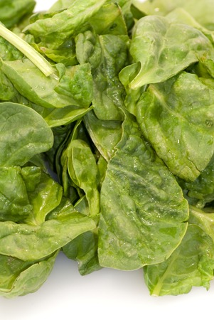Fresh green leaves spinach on a white background - Stock Image photo