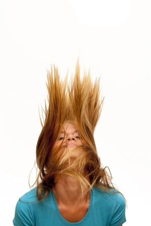 Portrait of Beautiful Blonde Woman  Shaking Her Hair Over White Background