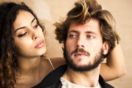 Beautiful portrait of a loving couple. Shes pulling his hair.