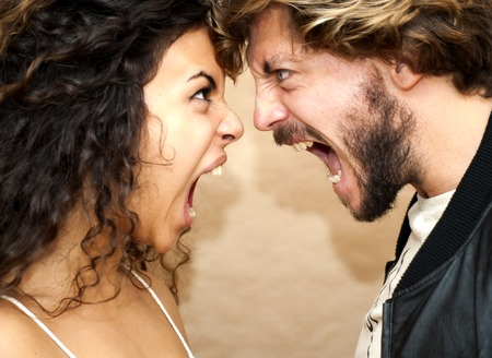 Beautiful portrait of a loving couple. They are screaming angry. Stock Photo