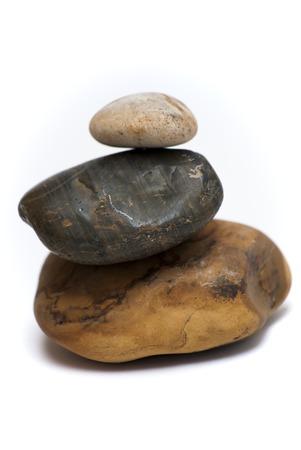 piled: Three Piled Stones on white background