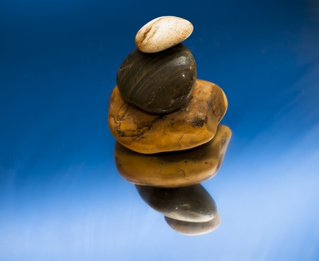 piled: Three Piled Stones on a Mirror