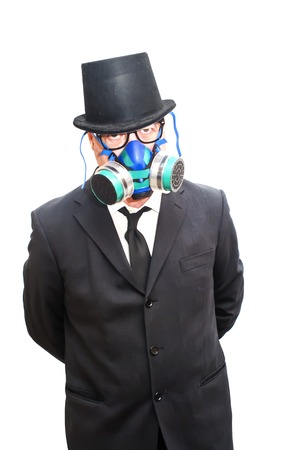 catastrophe: Businessman with gas mask and hat over white