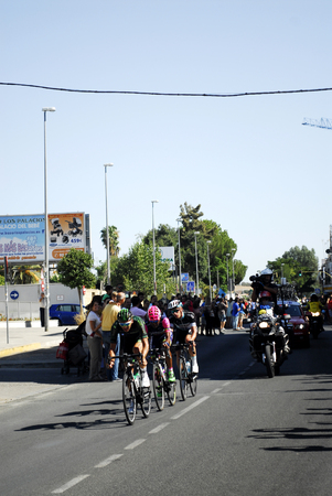 newscast: SEVILLA, SPAIN - AUGUST 26, 2015: Runners bike in the championship of the Tour of Spain on his arrival in Seville on August 26, 2015, Sevilla, Spain