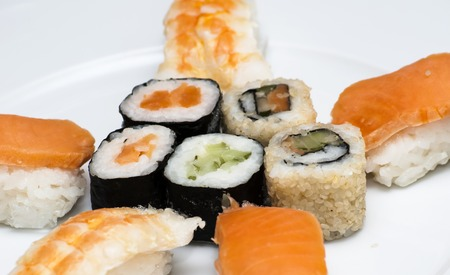 Tasty Japanese sushi set on white plate Stock Photo