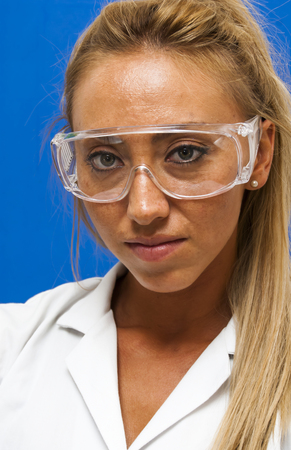 hectic: Beautiful woman doctor with special glasses on blue background