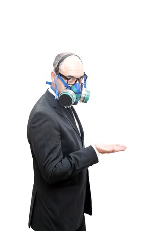 catastrophe: Businessman with gas mask and open hand over white