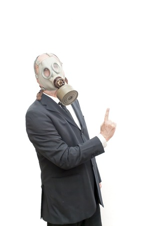 catastrophe: Businessman with gas mask  pointing his index finger up over white
