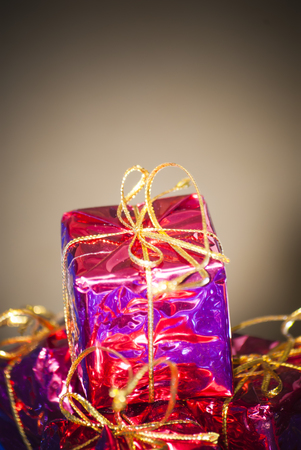 gift packs: Christmas gift packs with different colors and gold ribbons