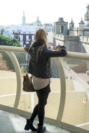 Beautiful woman walking around the old city