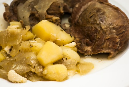 the cheeks: Tasty Pork cheeks with potatoes on a white plate