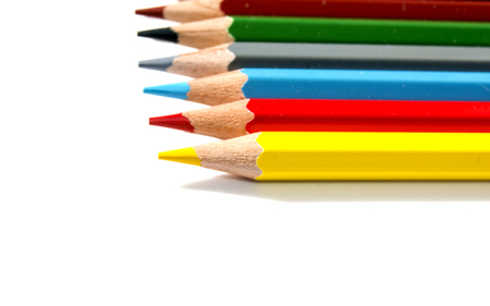 assignments: Colored pencils isolated on white background