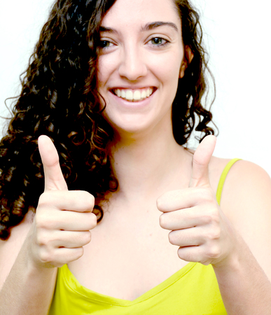 Beauty Woman With the thumb up sign of optimism Portrait Isolated over White Background