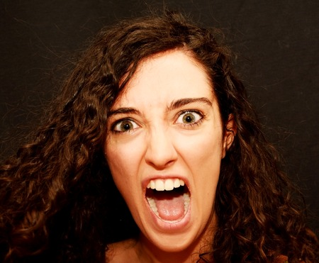 Beauty Woman Portrait screaming  Isolated over Black Background