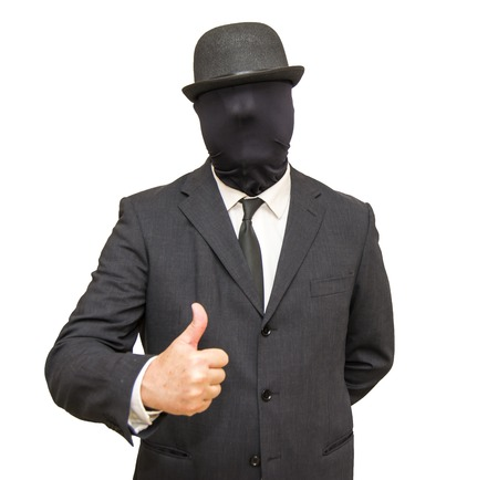 well head: Businessman with with his head hidden by a balaclava turned and a hat and with thumb raised as a sign that all is well on white background