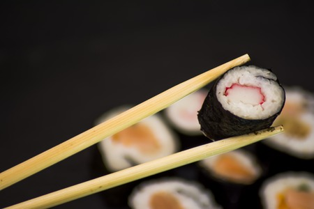 Tasty Pieces of sushi on a black stone