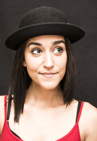 Portrait of a beautiful woman  with hat on black background Stock Photo