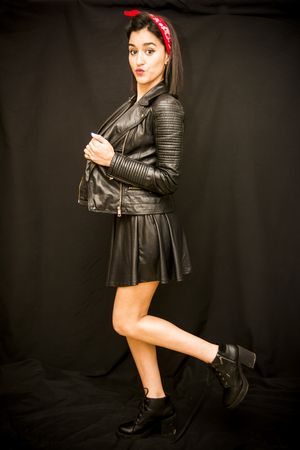Portrait of a beautiful woman  with leather jacket on black background Stock Photo