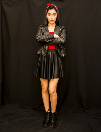 Portrait of a beautiful woman  with leather jacket on black background photo