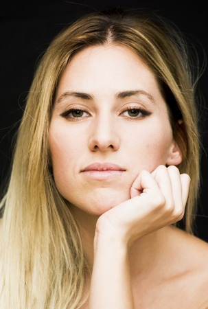 Portrait of a beautiful woman on black background Stock Photo