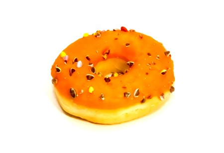 Sweet tasty donut with colorful sprinkles isolated on white background 免版税图像