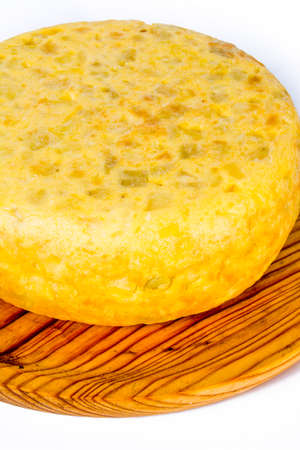 Spanish omelette on a wooden tray on white background 版權商用圖片