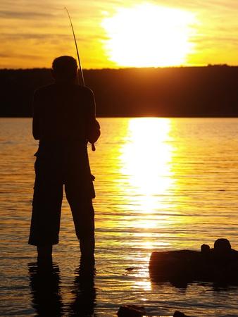 Fisherman in sunset photo
