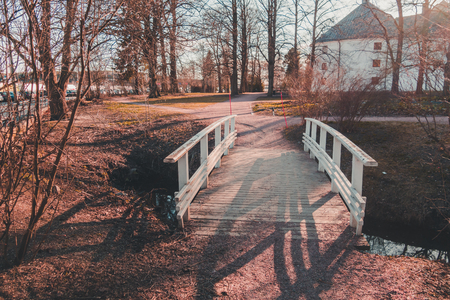 Finland Turku, small bridge over the ditch at Castle of Turku on a spring evening with sun shining