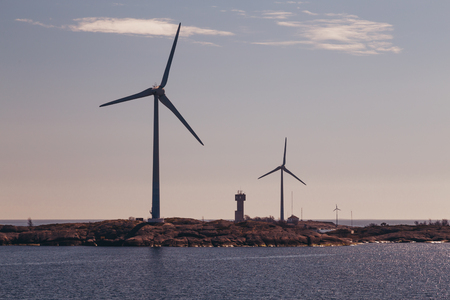Finland Aland, Islands of Lilla Batskar outside Aland with wind mills on a sunny spring day and calm sea