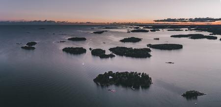 Islands at the archipelago outside Helsinki Finland at sunset on an autumn evening 免版税图像