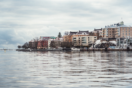 Older apartment houses with a great view at the coast of Helsinki Finland on a cold winter day