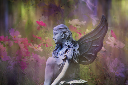 Fairy statue with flowers Stock Photo