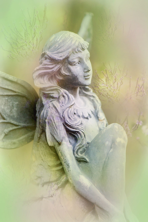 Fairy statue and pastel flowers