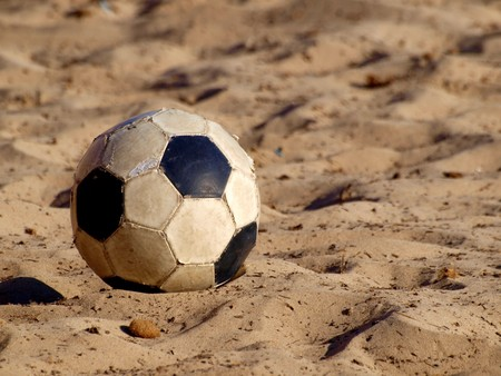 soccer ball on a beach in white and black leather photo