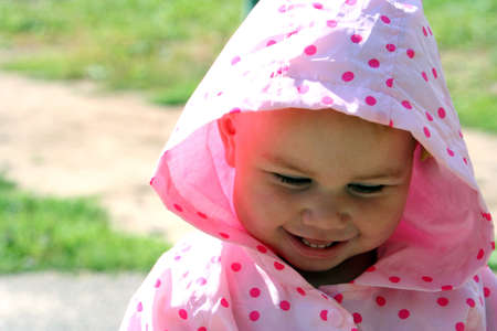 Little girl smiling and being embarrassed photo