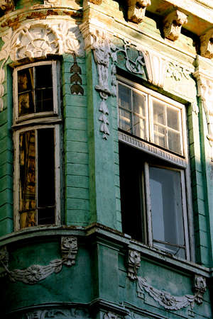 The corner and windows of an ancient masterpiece - the green house in barocco style