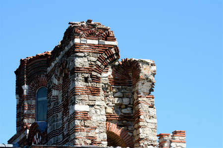 The top of an old church with the unusual repeataple pattern of brickwork