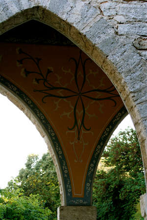 The part of an Arch with the bulgarian pattern and ivy on it photo