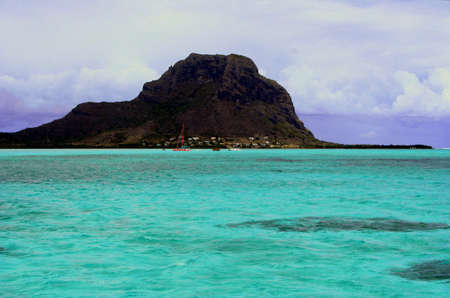 A Turquoise lagoon in Indian ocean near the mountain of Mauritius